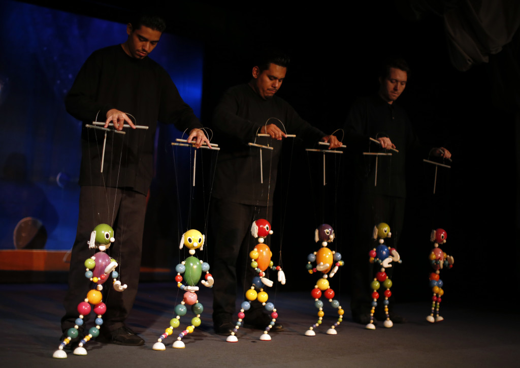 Puppeteers control marionettes during a performance at the Bob Baker Marionette Theater in Los Angeles