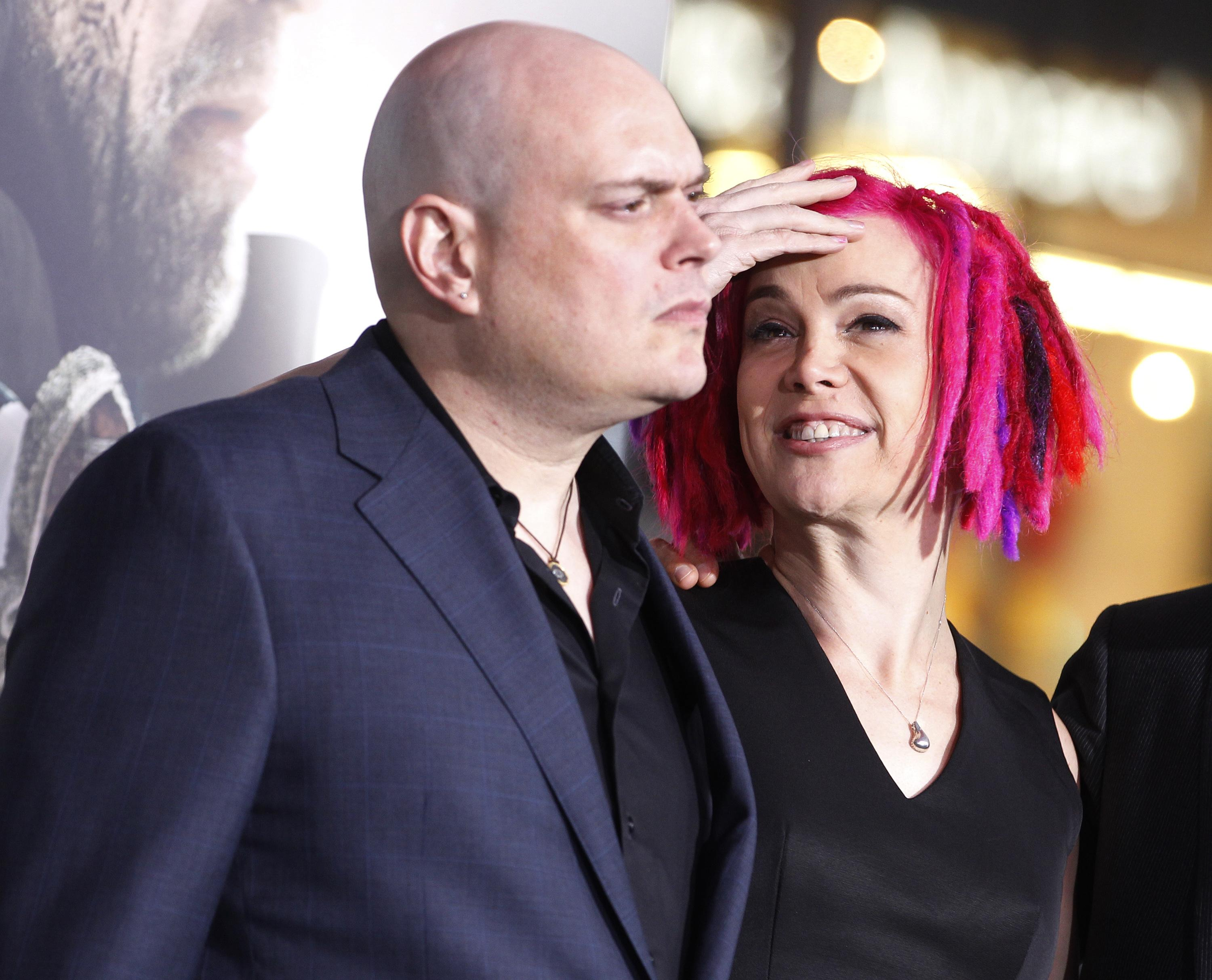 "Andy Wachowski (L) and sibling Lana Wachowski, the screenwriters, producers and directors of the new film ""Cloud Atlas,"" pose as they arrive for the film's premiere at Grauman's Chinese theatre in Hollywood, California, October 24, 2012. Lana Wachowski, who was formerly Larry Wachowski, has become the first major Hollywood director to publicly come out as transgender. Wachowski and her brother Andy directed the hit film ""The Matrix."" REUTERS/Fred Prouser (UNITED STATES - Tags: ENTERTAINMENT) - RTR39JX6"