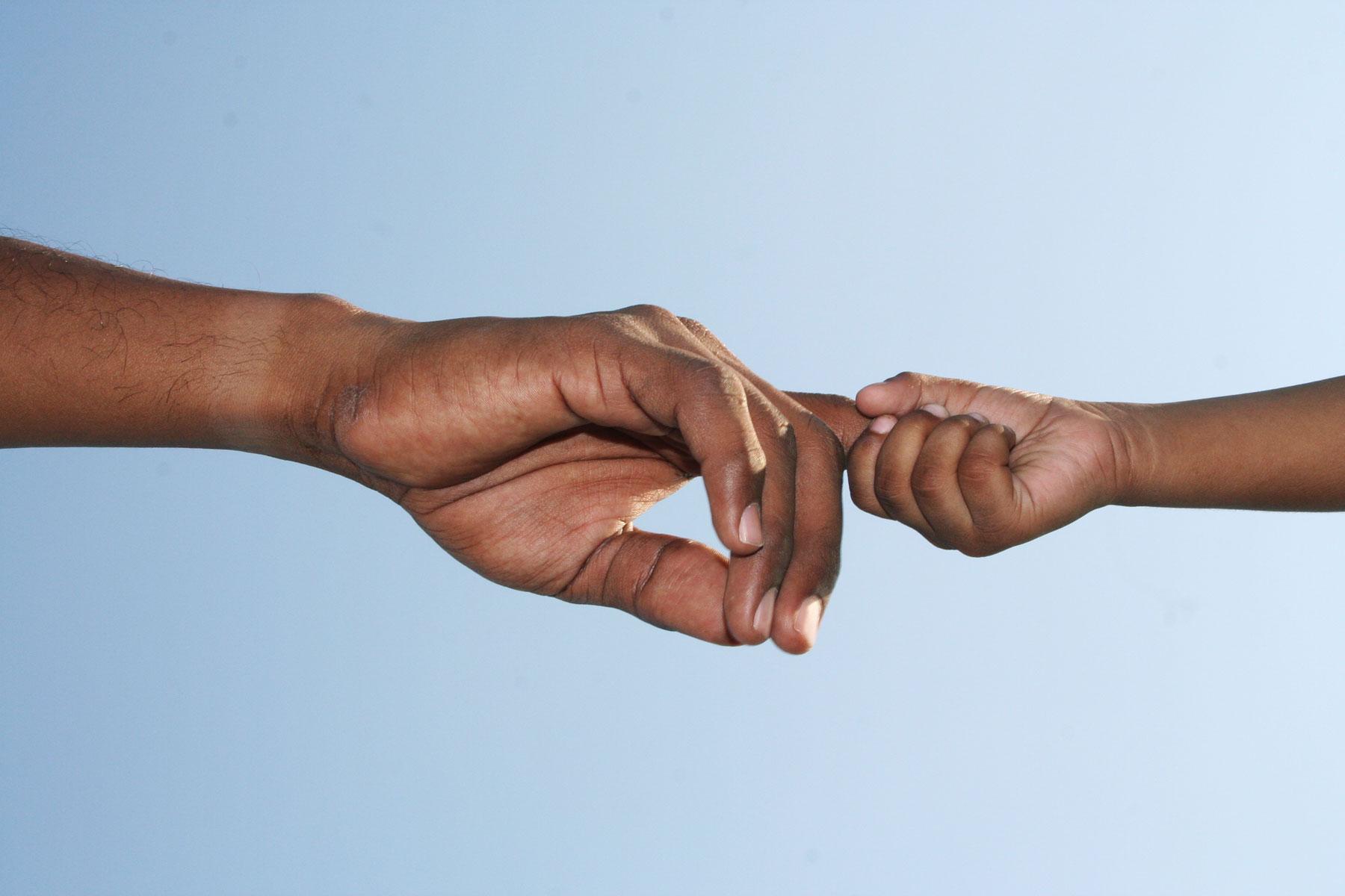 adult-child-hand-grasp